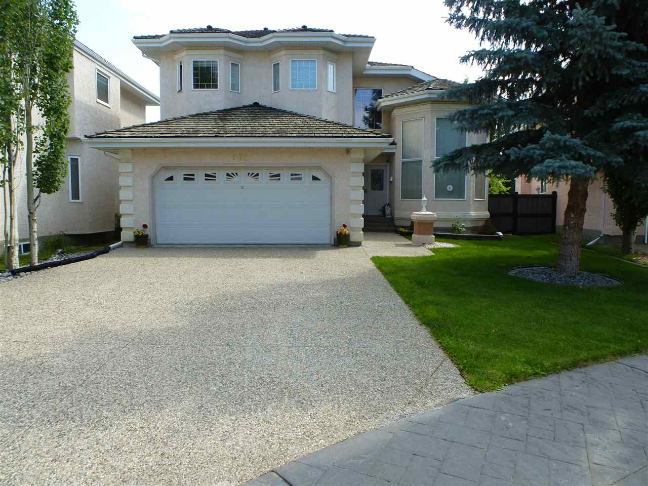 Welcome to Henderson Estates! You'll love this greatly sought after upscale family neighbourhood skirting the river valley where you can enjoy peaceful nature walks, Terwillegar Dog Park, the beautiful river valley only step away. Elegant 3,008 S.F., 5 bdrm, two storey in a key hole crescent. Spacious foyer with curved sweeping staircase, soaring ceilings in living room & formal dining room trayed ceiling. Spacious & well planned kitchen with additional private spice kitchen, Granite Counters, Large island, sunny breakfast nook overlooking the back yard & stunning family room with custom fireplace. Den/Bdrm, 4pc guest bath & main floor laundry. 4 Bdrms upstairs with a MASSIVE master suite with his & hers closets & Jacuzzi ensuite.  IMPRESSIVE basement development with rec room, 2nd kitchen, bedroom, den, 4pc bath, cold room, storage. Private fully fenced yard, large deck, shed, central Air, schools, shopping, parks, public transportation, Anthony Henday & Whitemud close by...a prefect family home!!!