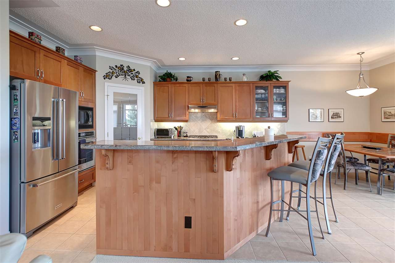 The galley type style kitchen is the most efficient style you can have as everything is just steps away. The lovely granite is used throughout and the desk plus insert on the dining table all matches.