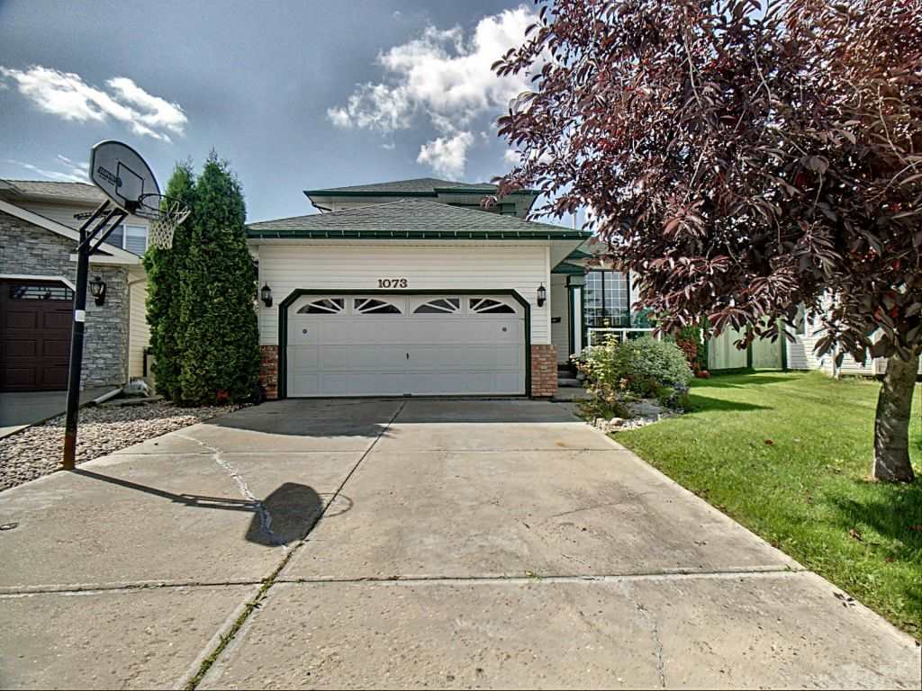 This former 2-storey show home located in a quiet cul-de-sac on a huge pie-shaped lot in Lewis Estates that has been meticulously maintained is an absolute must-see. Fantastic location that is close to public transit, schools, parks, easy access to the Anthony Henday/Whitemud and within walking distance to the golf course. With new windows/window coverings, new roof shingles and recently installed hardwood floors throughout this showstopper is move-in ready. The main floor has an open concept floor plan with a built-in kitchen pantry and large windows that allow plenty of natural light and a gas fireplace to keep you cozy during the winter. The backdoor opens up to a massive fully landscaped and fenced backyard with a huge composite deck The upstairs contains 3 bedrooms with a spacious master bedroom that boasts a walk-in closet and a 4-piece en-suite bathroom that includes a whirlpool Jacuzzi tub.