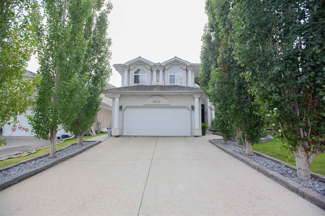 One of the finest homes in WEDGEWOOD HEIGHTS! Buy the Neighbourhood, View and the House - All in one package! Situated in one of the most prestigious neighbourhoods in the WE with mature trees, park, tennis court, new and amazing playground, endless trails and nature at your doorsteps; this ready-made home awaits you. Pride of ownership shows in every corner. Gracious foyer with stunning staircase & soaring ceiling will great your family & friends. The home is OUTSTANDING! Over 3,000 sq ft + fully finished bsmt +private yard overlooking the green belt. Main floor offers living, dining, family and den plus spacious kitchen. Tons of upgrades: hardwood, granite counter tops, stainless steel  appliances, central AC, paint & home jewellery... 4 large bedrooms & a loft are on the 2nd floor. Master bedroom suite is your private retreat. Bsmt is fully done and looks like an additional house with a separate entrance through the garage. And an amazing yard! MUST SEE! Leaving will be impossible!