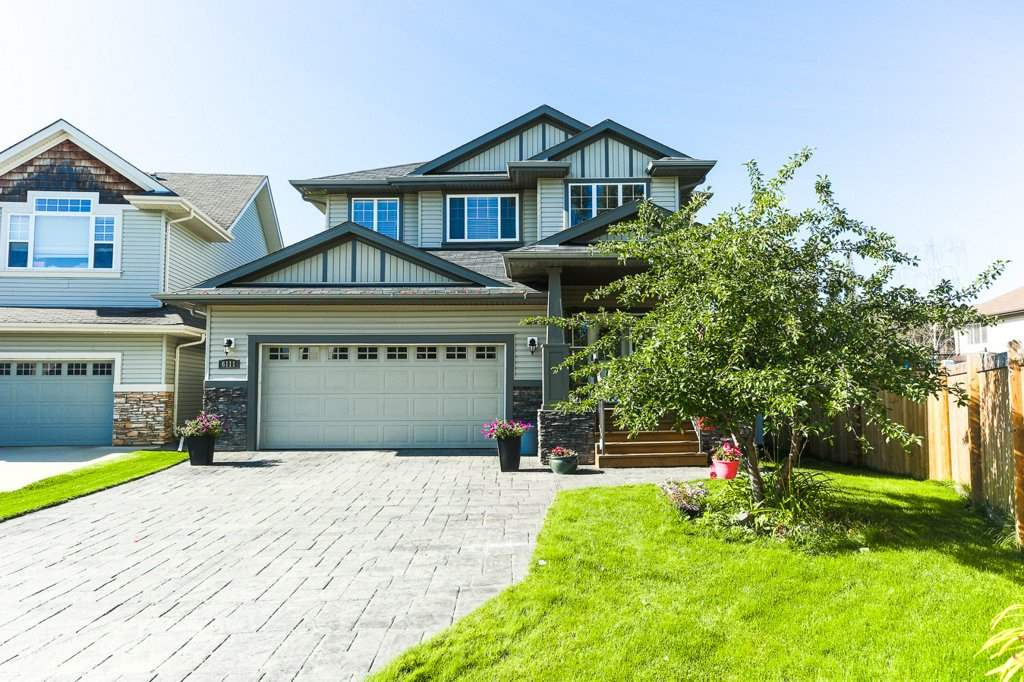 The Stinson Stunner - 2300+ sq ft of custom-built elegance, with luxury features and a great location that make this an incredible value! Ideally situated at the end of a quiet cul-de-sac near the spray park, this home has a brilliant layout that families can appreciate, including 3 bdrms up (the den/flex room on the main could easily be a 4th), large bonus room and spacious kitchen with walk-through pantry). Then there are the high-end features: stamped concrete driveway, fully finished garage, central A/C, cathedral ceiling at the entrance, 9? ceilings through the main, 2 fireplaces, and granite throughout. Upstairs, the 2 bedrooms are oversized, while the master features a walk-in closet and 5 pce ensuite with soaker tub. The landscaped backyard is great for kids and for entertaining, with both a two-tier deck and a stone patio, plus trees that create a park-like setting. All this in a great neighbourhood, with parks, trails and playgrounds nearby, plus easy access to the Rec Centre and Henday.