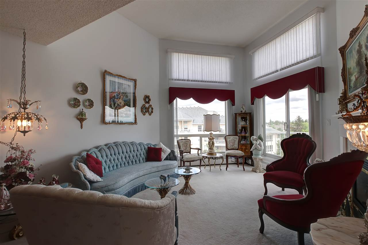This unit has a lovely gas fireplace in the open great room layout. Neutral carpeting and paint actually make the already generous space look even larger.