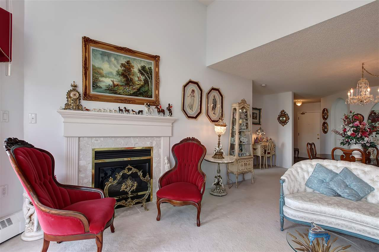 The open great room includes a formal living room area and dining space.