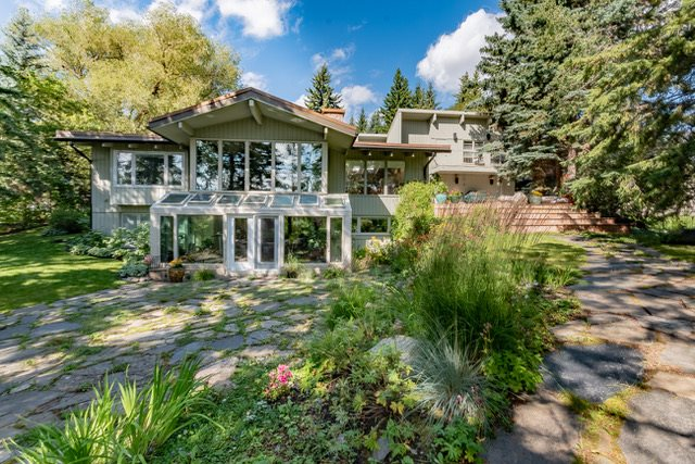 Sanctuary in the City, Stunning, private, home designed by Edmonton?s renowned first female Architectural firm of Wallbridge and Imrie in 1962. The mid century modern, clean lines of this home make it the perfect design to blend in with the nature that surrounds it. On a quiet and deep ravine, it truly feels like you are in the middle of the country and yet you are right in the city. South facing and designed with floor to ceiling windows through-out, the sun and trees join you in every room. An indoor pool, large loft and massive family room were added in 1978, (totaling over 6000 sq ft. of living space) making this an amazing home for entertaining family and friends. It has seen only 2 owners in its time and has been the center of much joy. If you?d love to have deer and an adorable fox wander through your yard on occasion and you appreciate beautiful architecture, then this is the home for you.