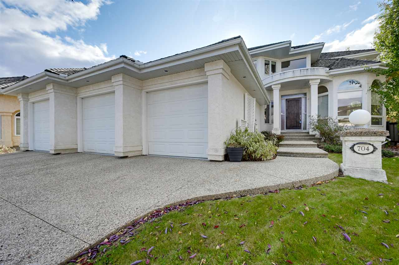 WOW! Stunning Estate home nestled on a private mature treed SW facing 12,507 sf pie lot. 3021 sf 2 sty in Eagle Ridge features a heated FOUR car tandem garage w/epoxy floor + drain & accesses the back yard w/a 4th OH dr to a pad for boat/trailer. Main level features vaulted entry, den, formal living/dining rm + butler pantry & Great rm adjacent to a huge chef?s kitchen. Open layout ideal for entertaining. Kitchen has flat slab cabinets, granite, island, 36? gas cooktop, 2 wall ovens, Sub-Zero fridge+ freezer & a W/I pantry. Huge mudrm for the kids sports gear. Upper level mstr suite has a huge W/I closet+ 6 pc spa ensuite w/steam shower. 2 more big bdrms- W/I closets & 5 pc bath. F/FIN w/a massive rec rm w/wet bar & fridge, gym, bdrms 4 & 5, 4 pc bath, ample storage + separate entry from the garage. 9/12 ft ceilings, newer upper carpets, refinished hardwood, W/I linen closet, B/I Speakers, maint free covered deck & patio, In-floor heating (bsmt), central Vac + A/C. Quiet locn steps to parks/ravine trails
