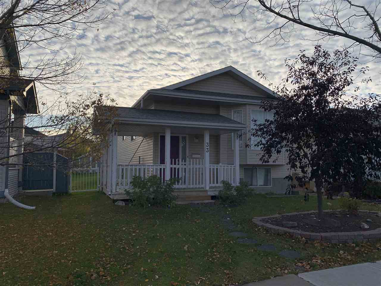 A bright bungalow located in Popular Tribute - across from park and pond. Neutral colors throughout this spotless home. Brazilian hardwood throughout the main floor, upgraded Lino in kitchen. All appliances and window-coverings stay. A cozy gas fireplace compliments the fresh living room area. There are 2 bedrooms on the main floor with a full bathroom to complete. The fully finished basement offers a family room, 2 beds, full 3 pce bath, laundry and utilities,  and a complete kitchenette area. There is back alley access with parking pad. Easy and a pleasure to show..