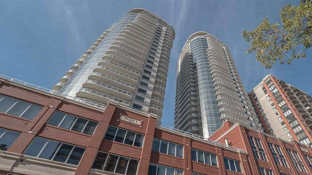 Excellent value in an Iconic tower!  This 2 bedroom 2 bathroom unit faces east and overlooks Rogers Place and the Ice District.  The kitchen features rich espresso cabinets, granite counters and stainless steel appliances.  Overlook the view out your large living room windows while you prepare dinner.  The balcony with 2 sets of doors, one off the master bedroom and the other off the living room is very spacioius and a perfect hangout spot in the summer.  Other features include In-suite laundry, laminate flooring and a heated UG parking stall (titled).   Outside there are Cafes, dining, & shops steps away.  LRT pedway is right across the street and Grant MacEwan College is in walking distance.
