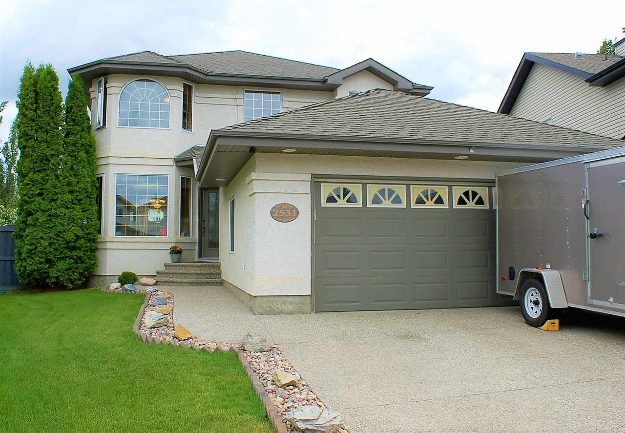 well built Home 2407 sqft 2 Storey w/oversize front attached heated garage (22?x27?x9?) well maintained in Terwillegar Gardens located in a fantastic neighbourhood largest pie shaped lot in the cul-de-sac for your family to enjoy! This home also has back lane access to easily park your RV. Garden Doors off the kitchen open on to a spacious 18' x 28' deck with N/G BBQ, great for entertaining, w/stairs on either side. This well maintained home features 9' ceilings, Oak throughout, Living room, dining room & family room w/wood burning fireplace on the main floor. Master bedroom w/Ensuite plus 2 bedrooms and open bonus room on 2nd floor, also exposed aggregate driveway/walks/steps, Perimeter motion sensor pot & flood lights, Hard wired front & rear motion sensor security cameras, Smart wired LAN Cat-5 throughout, Family room & deck surround sound wired, Bay windows throughout, Family room Floor-to-Ceiling window, California Knockdown Ceilings, too many upgrades features to mention.