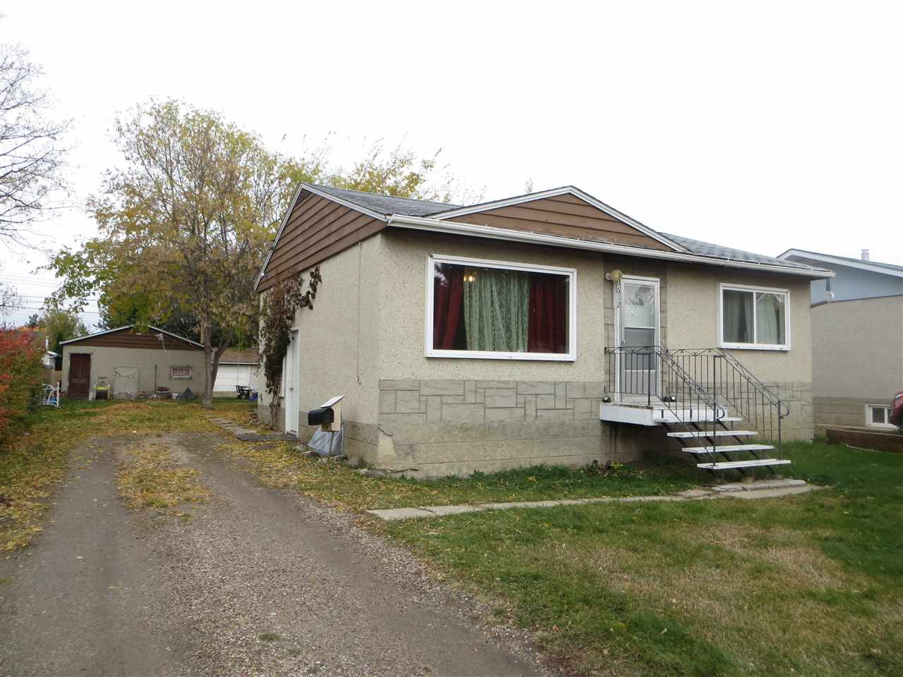 Excellent redevelopment opportunity!  50' x 148' lot on a quiet street steps to a park.  Many opportunities are bundled with this affordable home, rent it out, or knock it down and build or you can renovate.  Some of the more expensive upgrades have been completed to this home over the years including: windows, shingles, hot water tank, 100 amp electrical service.  Double garage is oversized, 20x24 with back lane access, and parking also is available from the front yard.  Total of 3 bedrooms (2 up and 1 down).  Quicker possession is also possible (November 1st).