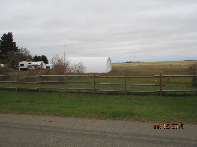 Approx. 4 acres of fenced  land with ( 1.93 acres each  with 2 separate titles) in Village of Andrew with beautiful EGG CREEK bordering the NORTH AND AND A LITTLE BIT EAST of this wonderful property. All utilities are to the property line with Edmonton water being a bonus.comes with canopy style storage shed with lots of room for Quads, lawnmower, and tool storage. Perfect place to hang out on, plus you can build your new dream home here also.. Excellent soil for hobby farm enthusiast , plus lots of room for a few animals ... address for second parcel  is 4816 - 52 ave and have to be SOLD TOGETHER ... FOR GREAT PRICE OF $44,900.00  If  a person is having a hard time could sell off one of the parcels..There is also a development permit paid for and in place for 1 year for a 40' x 60' shop  from Aug 2019 to  Aug 2020.. bonus for buyer ....