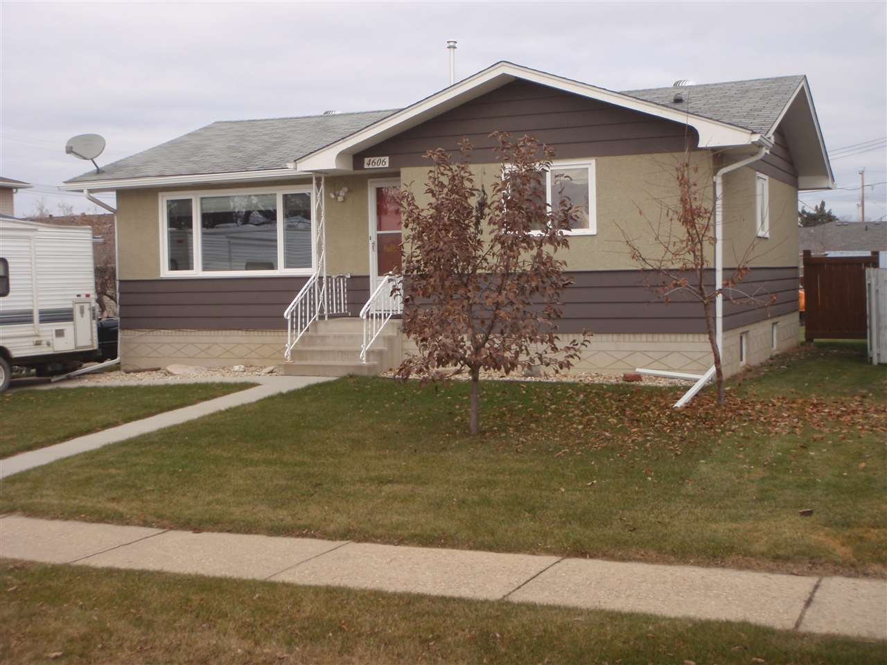 LIKE NEW! Renovated 2+1 Bedroom 955 sq.ft. bungalow on east side of town. Upgrades in past 8 years include: windows, doors, furnace, hot water tank, main floor 4-pc bath, 100 amp breaker box, interior paint (up & down), natural gas fireplace, fence, 10x20 deck, landscaping & firepit. The basement has also been completely developed in 2011 (large rumpus room, 3-pc bath/laundry combo, bedroom and 2 storage rooms). Also new in last 8 years is the 24x25 garage (vinyl siding) with concrete floor and huge concrete pad, plus concrete parking pad in front of house along with concrete sidewalk. Comes with 2 storage sheds and garage workbench/cabinets/shelving.