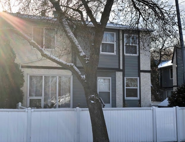 Hate facing into your neighbor?s yard? Tired of no privacy? Then you?ll love this corner townhouse featuring unobstructed window views from both living and dining areas, and all bedrooms. This property comes complete with 1244 sq.ft. of total living space and boasts 3 bedrooms, 1.5 baths, finished basement, 4 ceiling fans, plush upper-stairway carpeting, plus a $10,000. touch in beautiful vinyl plank flooring throughout main and upper levels (year 2017). It's waterproof, noise proof and child/pet friendly!    Additional upgrades include new hot water tank (2019), furnace (Oct. 2011), upgraded bath (2013), vinyl windows, and low maintenance vinyl fenced yard. This property is exceptionally located to all amenities, schools, bus transit and main traffic arteries, and is just steps to park area and Kennedale Ravine. Pets allowed with board approval (no size restriction). Convenient visitor parking. Property is priced right with quick possession available.