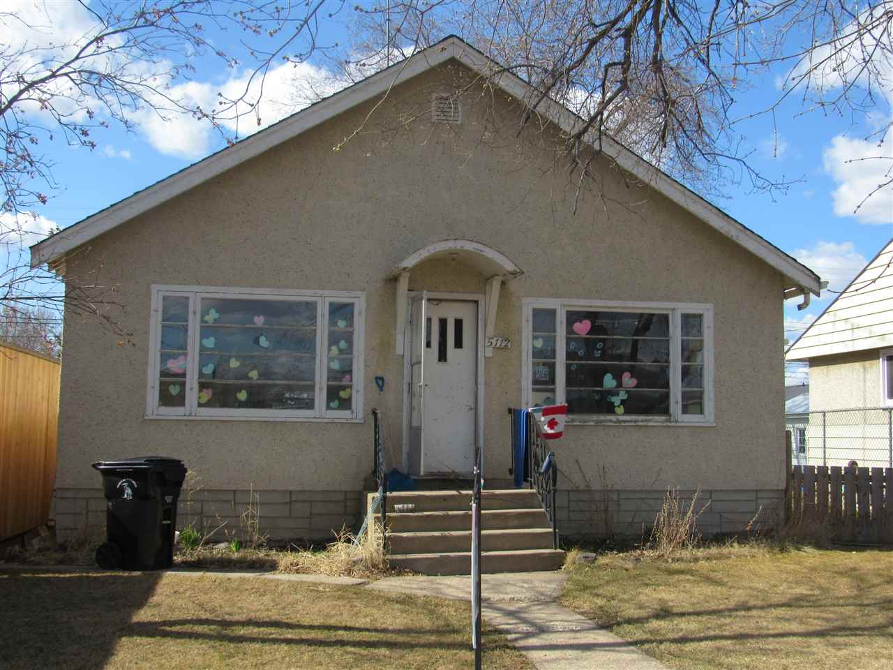 Lots of potential with some TLC here. This 3 bedroom bungalow has original hardwood floors, a big kitchen and living room and the bedrooms are a nice size. Located close to schools and downtown, it could be perfect for a young family.There is a newer furnace and a brand new hot water tank. It has a full basement for storage and a big backyard as well.
