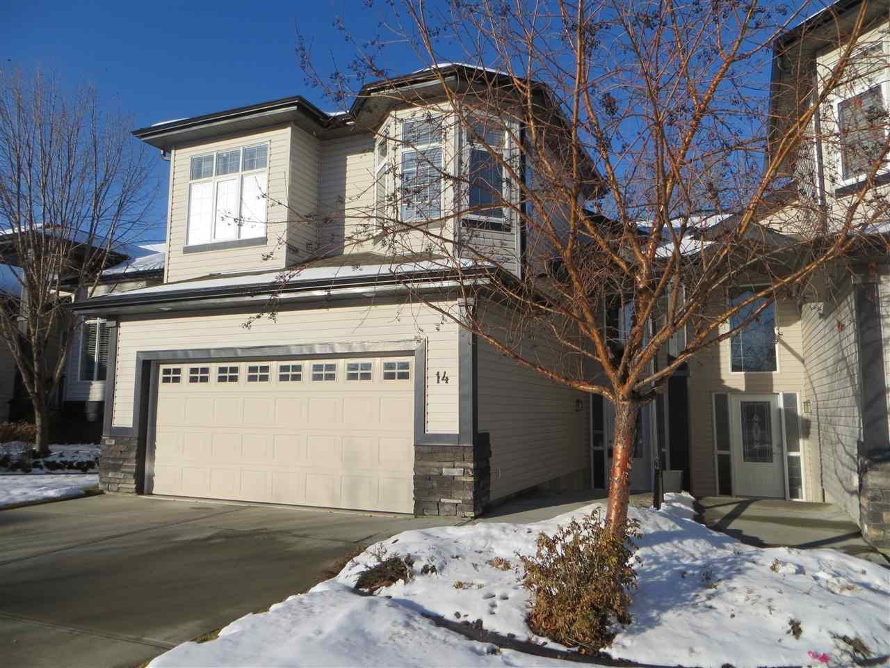 Excellent value for this duplex style condo located in Rutherford with nearby schools, shopping, grocery amenities, quick access to the Henday and under construction LRT park & ride, minutes from future site of new hospital. Maintenance free exterior; condo fees cover snow removal, landscaping, irrigation and exterior maintenance. Natural gas BBQ hook up on deck; prime location backs onto a quiet acreage, ideal for privacy. Main floor features open concept formal dining room, living room with fireplace, nook and kitchen along with a full bath and bedroom. Upstairs is your master retreat with spacious bedroom, ensuite with soaker tub, separate shower and walk-in closet. Lower level has large rec room, two bedrooms and full bath along with large laundry room and storage under stairs. Stainless steel appliances, granite countertops in kitchen, undermount cabinet lighting, air conditioned. Spacious foyer entryway and large double attached garage; garage floor has had coating applied in last two years.