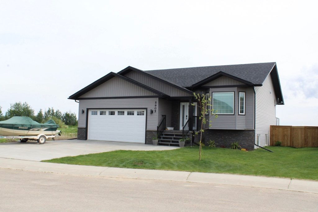 SPECTACULAR, MODERN, STYLISH. Three words that only begin to describe this meticulous 1400 sq ft Custom Bungalow in the NE corner of Barrhead. Private semi cul de sac location close to kids Park w/ sweeping views of open fields from the back deck. Masterfully designed professional Chef's Kitchen featuring dark high wall cabinets, custom tile back splash, Quartz & Granite counter-tops, corner Pantry & quality SS Appliances. High vault ceilings continue throughout main floor living & dining creating bright & inviting space for you & your guests. 2 main floor Bdrm's w/ option for 5 total. 3 full Baths include a master Ensuite featuring His + Her sinks & dual head custom tiled shower. Fully finished wall to wall open concept bsmnt w/ large recreation & T.V area complete w/ feature rock wall & gas fireplace. Air Conditioning, Central vac, In floor heating lines, Fenced & landscaped yard, Spacious 2 car attached Garage, Attractive exterior colors & a Presence that demands Attention. This is the One!!
