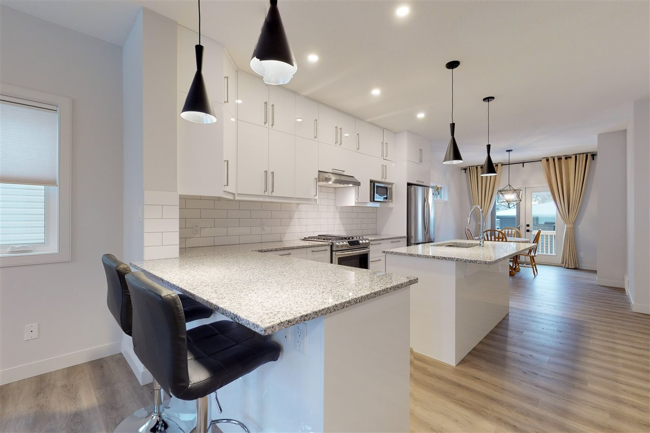 Welcome to Belgravia. This 2018 built spectacular home is in Edmonton's most prestigious neighbourhood. Steps from the River Valley and near a large park this home is across the street from one of the best elementary schools in Edmonton a community league centre for gathering and outdoor rink for kids hockey games. The location can?t be beat and no expense was spared in this 2018 built home. This elegant home features an open concept main floor. The upstairs includes a total of 4 bedrooms, 2.5 baths and a laundry room. . The master bedroom includes a walk-in-closet and large ensuite with double sink. The basement is partially finished with a separate entrance for easy basement suite conversion if desired. High end finishing throughout including custom cabinetry, vinyl plank floors, high end granite counter tops, high efficiency furnace, on demand hot water, stainless steel appliances, premium plumbing and light fixtures, double garage, 9 ft ceiling's, and triple pane windows.