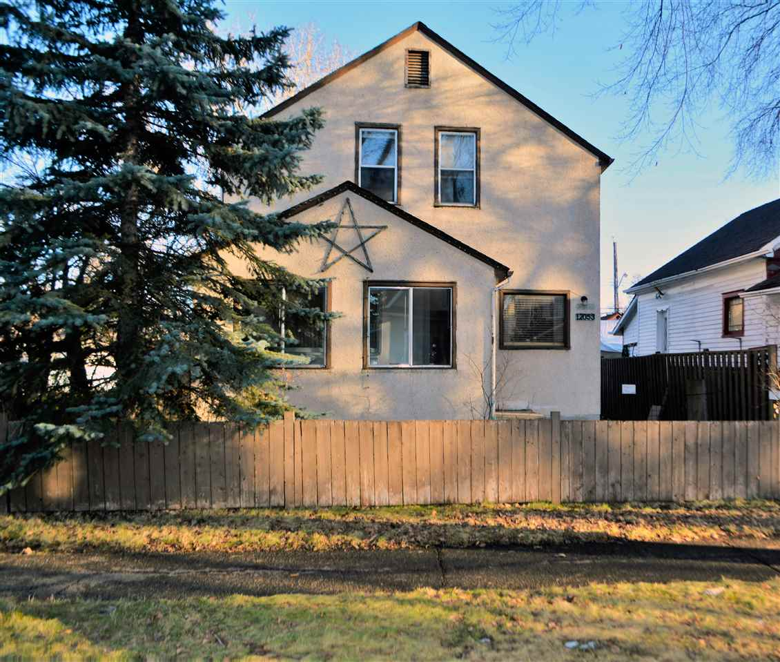 RF 3 zoning Investors. Character. This beautiful home has loads of character. Gorgeous street with a canopy of trees lining the street. Walkway path beside the owners with a plan by city to upgrade with benches and designs. 3 bedrooms with a large bathroom on the upper level. Beautiful original hardwood floors in the living and dining room on the main floor, glass door into the dining room and glass door knob. High ceilings on the main with a bright LED kitchen which has loads of room to work in and cabinets. Large porch in the front of the home with laminate floors - not included in the sq ft. Large heated porch on the back. Beautiful back yard with patio to sit and relax on those warm summer days and a apple tree. Unique mosaic patio and is very relaxing. Large cold cellar and unfinished basement with lots of storage. Large shed and single garage in the back. Lilac bushes and a yellow rose. The front covered porch is an additional 80 sq ft. Delton Elementary is close by approx 3 blocks. Upgraded furnace