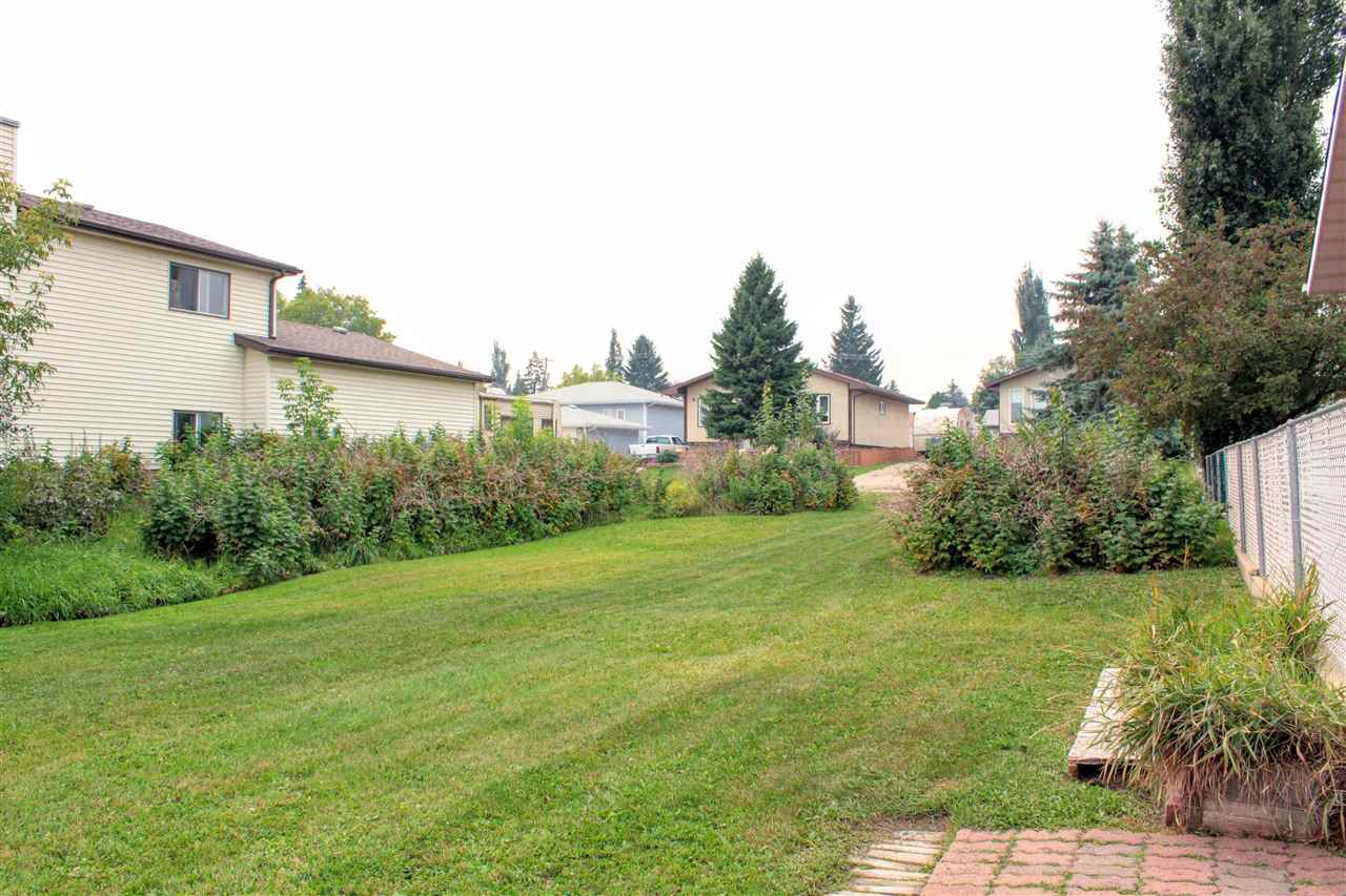 Beautiful lot with double garage and 2 sheds in a very established area.