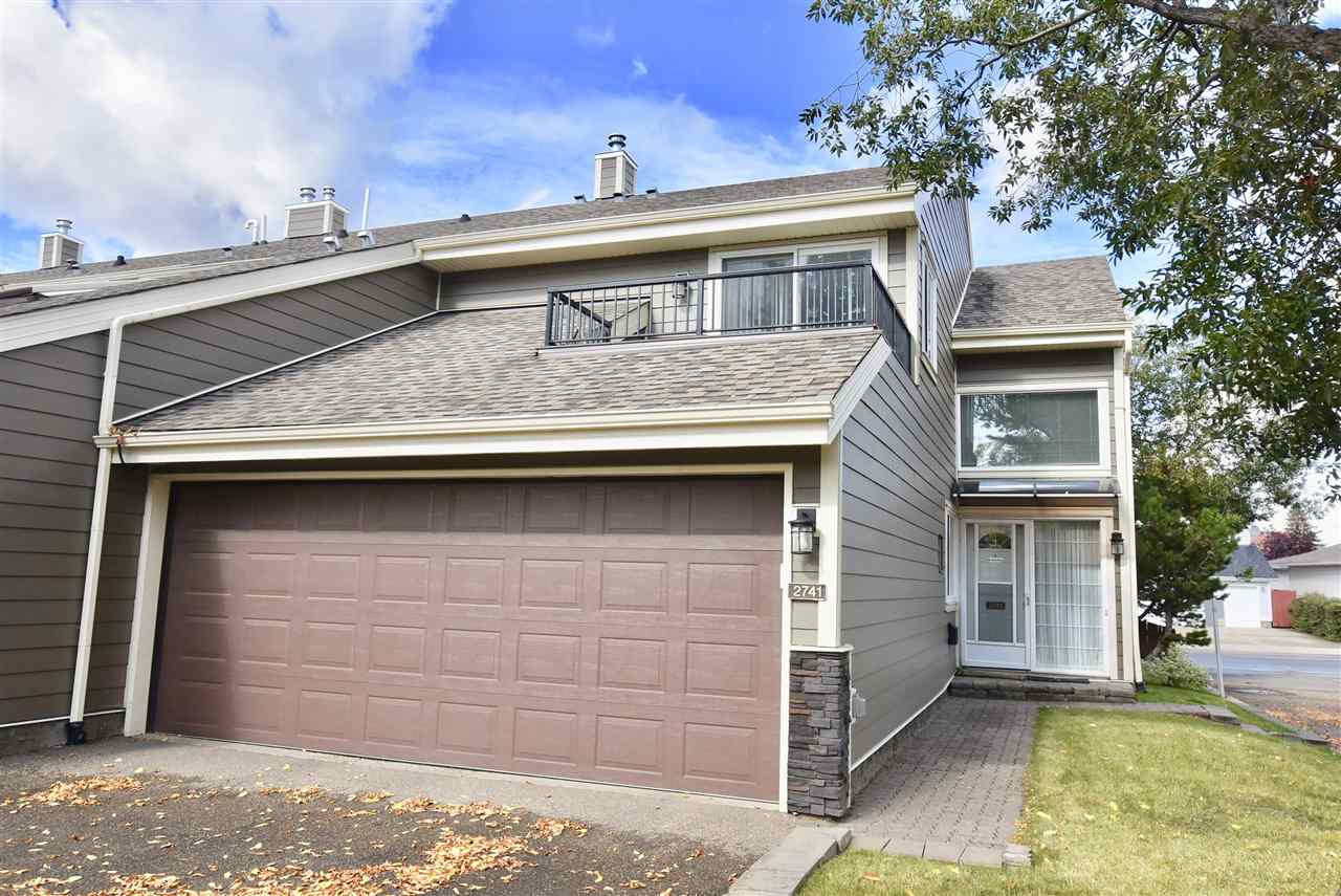 ****ABSOLUTELY AMAZING END UNIT TOWNHOME in BLUE QUILL ESTATES****. PRICED TO SELL!!  AMAZING VALUE!! 3 bedroom, 3.5 bathroom townhome with a double attached garage and CENTRAL AIR CONDITIONING.  The location is amazing, close to ravines, transportation, schools and Whitemud Drive.  The main floor features a large livingroom with a wood burning fireplace, the kitchen has loads of cupboard space, island with a built in stove, CORIAN COUNTERTOPS, built in oven and STAINLESS STEEL APPLIANCES.  The kitchen has a new ceiling installed with new light fixtures.  The eating nook off the kitchen is ample size for a table and a good place to enjoy your morning coffee.  The large formal dining room is great for entertaining and has patio doors leading out to the deck and yard, with a partially glassed in Gazebo, and firetable.  Upstairs there are 3 large bedrooms, including the master with its own ensuite and BALCONY.  The basement is fully finished and has a nice bar.  Newer Hot Water Tank and newer Central Vac.