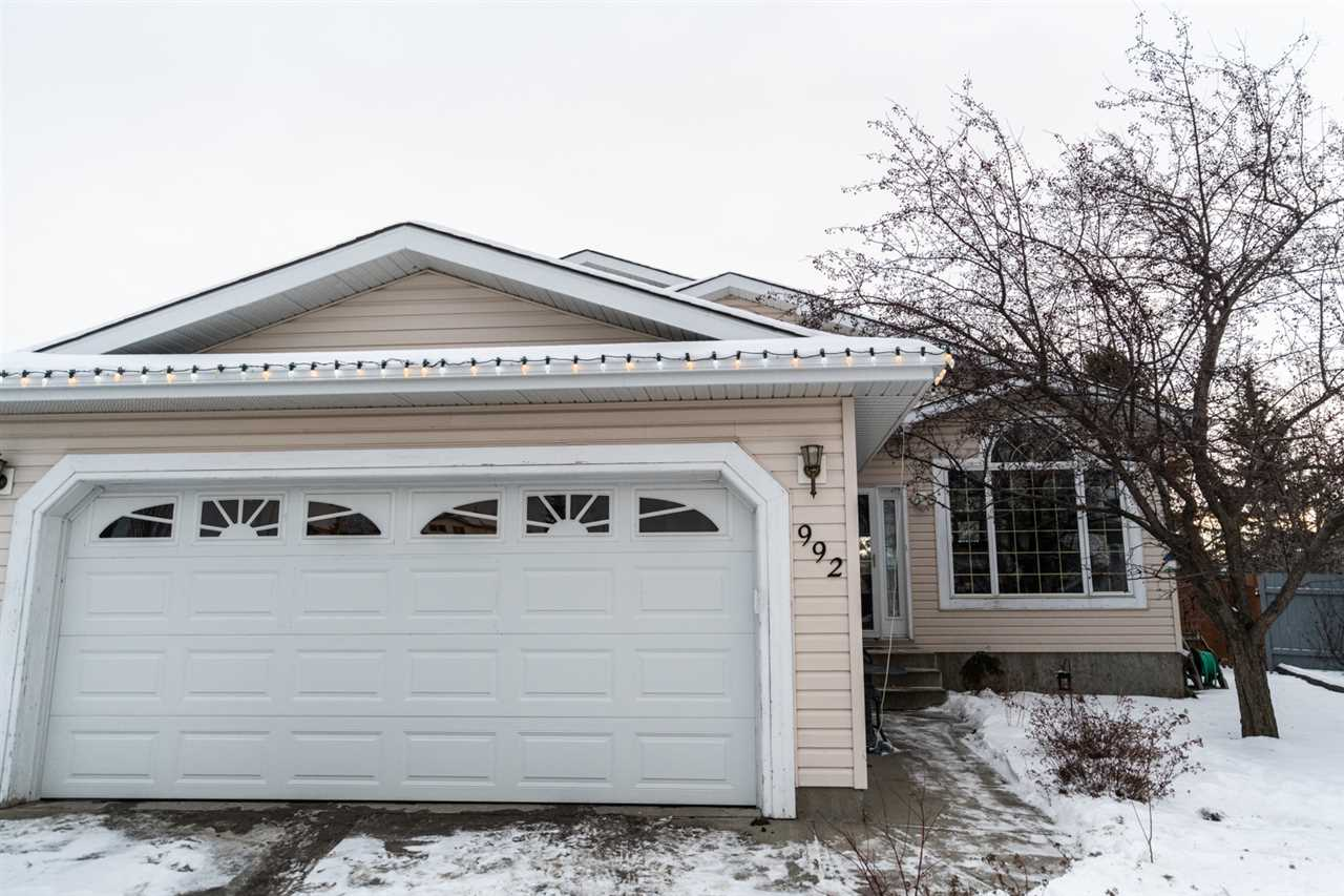 ABSOLUTELY MASSIVE BACKYARD! LARGE AND GENEROUS CUSTOM 4 LEVEL SPLIT HOME with almost 2700 sq ft living space, VAULTED CEILINGS, FINISHED BASEMENT, DOG RUN and in a CUL DE SAC! In Jackson Heights just walking distance to schools and playgrounds. Less than 3 MINS to the Whitemud! Walk in and FEEL the vaulted ceilings, Huge kitchen and oversized dining room with south facing windows. Top floor has 3 LARGE bedrooms and 2 Bathrooms; the master is HUGE and has a 4 pc ensuite and walk in closet! 3rd floor is COZY with it's 4th bedroom, GAS fireplace, and ANOTHER Full Bathroom and Laundry. The Backyard is literally 8,800 SQ FT!! With a two tiered deck. So you can ENTERTAIN, CLIMB TREES, THROW A FOOTBALL, whatever! It's a huge piece of earth. It has an APPLE TREE, CHERRY TREE, HERB GARDEN, RAISED VEGGIE GARDEN, PERENNIAL CHIVE AND ONION GARDEN. 2 ENTRANCES and a CONCRETE DOG RUN. Basement has an UPDATED FURNACE and HWTANK, 2 ROOMS and STORAGE for DAYS. PERFECT size for a family. Everyone has a space to exist!
