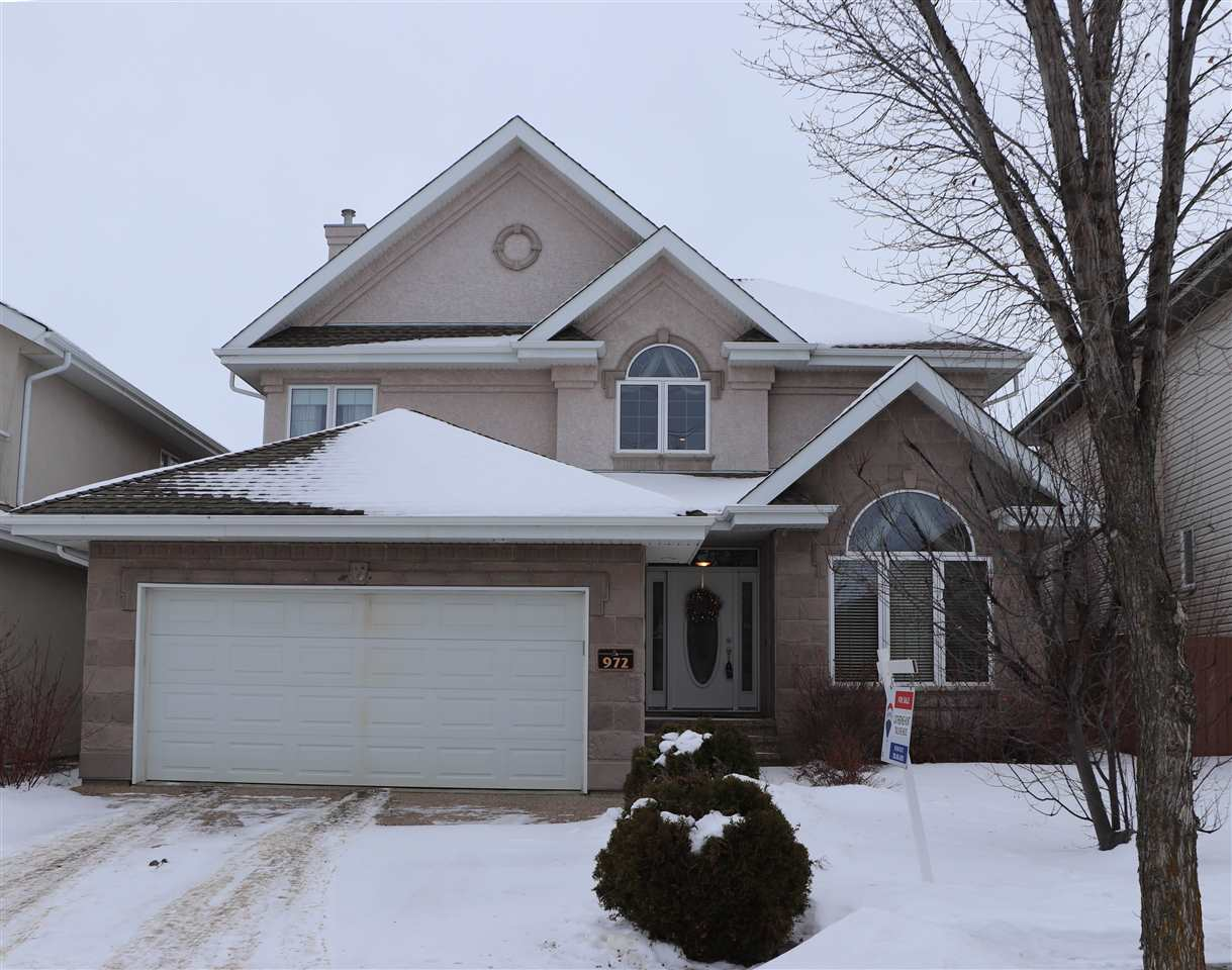 Welcome Home to your 2,895 sq. ft prestigious CUSTOM BUILT home in Hodgson Estates! The grand entrance leads you to an open concept layout with a DREAM KITCHEN with loads of cherry cabinetry, a MASSIVE GRANITE ISLAND, dining area and walk thru pantry. Adjacent is your Family Room with a BUILT-IN ENTERTAINMENT CENTRE and a formal Dining Room.  A Mud Room and 2pc bathroom complete this floor. Upstairs are 3 bedrooms including a LUXURIOUS MASTER SUITE featuring a 5PC ENSUITE and walk-in closet. A LARGE LAUNDRY ROOM with plenty of built-in cabinets and 4pc bathroom finish this level. Downstairs you?ll find a MASSIVE Rec Room, 2 more bedrooms, another 4pc bathroom & plenty of storage. A few special features of this home include crown molding, A/C, 2 furnaces, 2 hwt?s, oversized double garage, south facing backyard, and large deck. Nestled on a quiet street and steps away from a PARK & RAVINE in the prestigious Estates of Whitemud Ridge. Located close to shops, restaurants, schools, and other amenities.