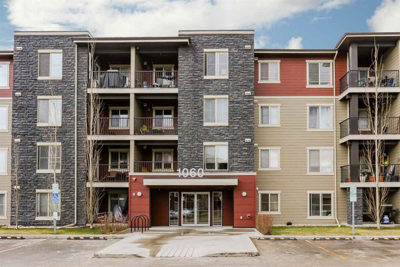 Very well maintained apartment style condo located in the desired community of McConachie. Features 2 spacious bedrooms with the Master Bedroom having a walk-through closet and a 4 piece en-suite.  As well, there is an additional 4 piece family bath, coved Kitchen with Granite counter tops and lots of cupboard space, a den/computer area, and a large living room with a door leading to a patio.  Finishing off this beautiful condo is its own laundry.  There are 2 titled above ground parking stalls included. What a great place to call home and is a real pleasure to show.