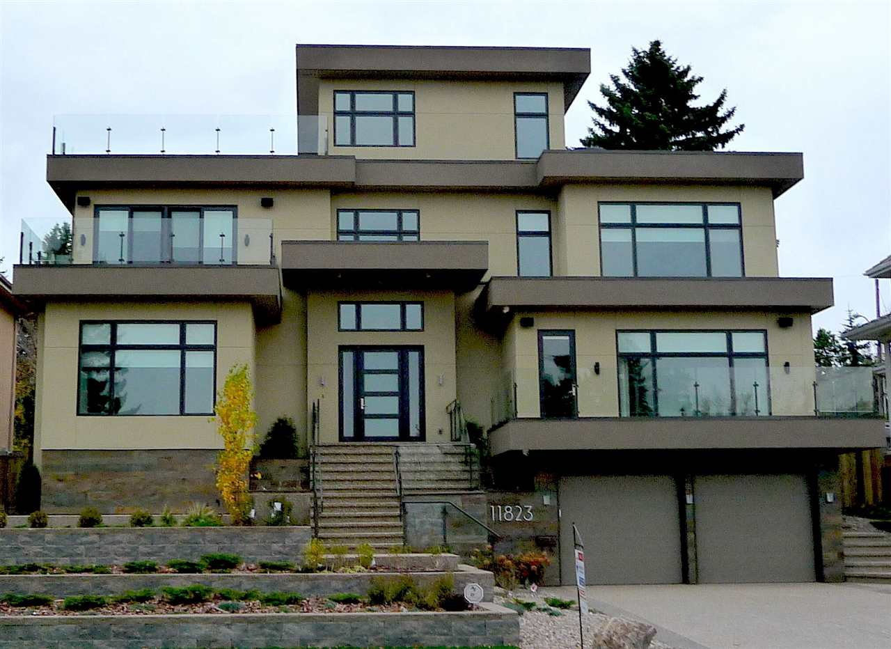 Supreme location with panoramic views of the city, city skyline and river valley. Over 5,000 sq.ft. on three levels (8,000+ on five levels). Elevator to all 5 levels. Large patio, 2 balconies, a roof-top deck/terrace, and a screened-in deck and an open deck. Huge kitchen with good quality appliances and a large island. Lots of bedrooms, fully-finished basement and a lovely theater room in the sub-basement. Parking for four vehicles in the double-sided tandem garage plus a parking pad at the rear for a fifth car. Walk to the hospitals, University of Alberta, or downtown. You must not miss this beauty.