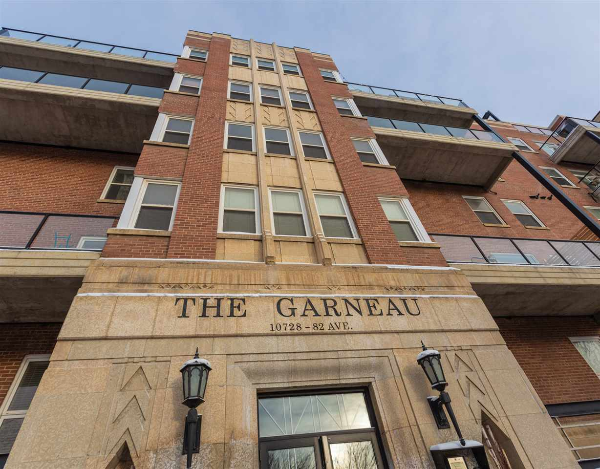Cool sophistication in sought after Garneau. Incredible executive condo in The Garneau, one of the coolest historical buildings in the city, located directly on Whyte Avenue toward the west side, walking distance to U of A. The decore offers great ambience throughout. Air conditioned, new heat pump, upgraded throughout on 2 levels with just the perfect amount of brick accents. The main level features an entertainment sized living room, chef?s kitchen with island, lots of counter space and ample cupboards, dinner party sized dining area, 2 piece powder room, large storage and plenty of west facing windows for gorgeous natural light. Head downstairs and you'll find a huge bedroom with a cozy fireplace, attached to a beautiful spa like bathroom with Jacuzzi tub. Convenient underground parking stall, and additional storage locker. Central location minutes to downtown, River Valley, fabulous restaurants, unique shopping, Old Strathcona Farmer?s Market, The Fringe, Art Walk and much more to do in your downtime!