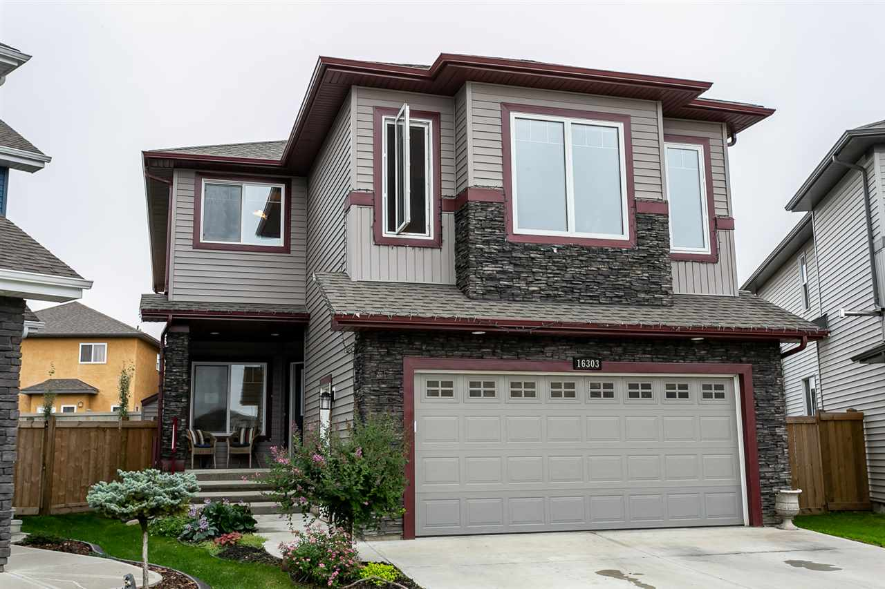 Located in a quiet cul-de-sac is where you will find this gorgeous 2565 sq ft Bedrock built 2 story. This fabulous family home has upgrades galore & very functional living space. Lge windows allowing in extra natural light. GR featuring hdwd flooring, a stoneface gas F/P. There is a huge breakfast nook off of the KI with doors leading to the deck. Gourmet KI with abundance of cabinets, pot drawers, granite countertops, lge island, gas convection stove, walk thru pantry, wine rack & SS appliances. The main floor also features a den with French doors, huge mud rm & a 1/2 bath on the main. Upstairs you will enter thru double doors to the spacious MB with a 5 pc ensuite including his/her sinks, massive W/I closet, lge glass shower & corner soaker tub. There are also 2 other good size bdrms, 1 with a W/I closet, upper floor LA rm, a 4 pc bath & a huge bonus rm with vaulted ceilings. The bsmt features 9 ft ceilings & is waiting for your personal touch. A/C + a heated dble attached garage. Great yard & location!