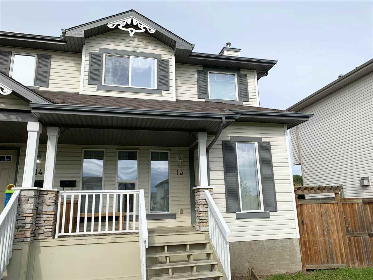 Welcome to this updated 2 storey half duplex in Southfork.  This home offers 1147 SqFt of living space including 3 bedrooms, 1.5 baths, open concept main floor, and a large landscaped yard.  Upstairs you'll find the spacious master bedroom with a walk-in closet, 2 additional bedrooms and a 4 piece bath.  The main floor features a beautiful kitchen that overlooks the backyard, all black appliances, and plenty of counter space. The open concept leads into the dining room and large living space with a corner gas fireplace, and a 2 piece bath completing the main floor. Back lane access for parking large enough to fit 2 trucks, as well as plenty of street parking, and overall great curb appeal. Upgrades include all new paint throughout, new vinyl plank flooring and brand new carpet.  Great value and location close to parks, schools, shopping, public transit and easy access to Highway 2, this is a perfect turn key starter home!