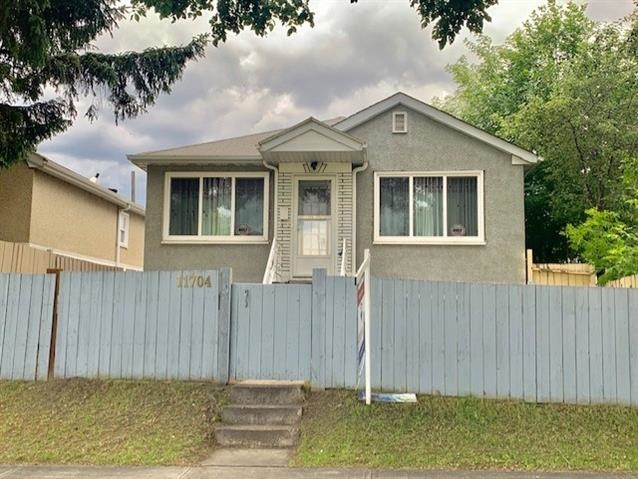 Welcome to this Stunning Bungalow with total of 4 Bedrooms, 2 Bathrooms & Single Detached Garage! Main floor features Large Living room with Bright Windows & Nice Hardwood flooring. Spacious Kitchen comes with Gorgeous Kitchen Cabinets & SS 2-doors Fridge. 2 Sizable Bedrooms all with Hardwood floorings. 4pc Bathroom with newer Vanity. SEPARATE BACK DOOR ENTRANCE to FULLY FINISHED BASEMENT offers 2 Bedrooms, rough in Kitchen, Cupboards, Sink & Counters, Bathroom & Laundry room. House were updated several years ago that City has given it an effective age of 1975: Painting, Hardwood floorings, Kitchen, Furnace, Hot Water Tank, Shingles, Fence, Side Walks, Road Resurfacing, Basement finished in 1998 ........Fully Landscaped & Fenced Yard. Easy access to Bus Stops/LRT/Shopping C/Schools/Nait/Downtown & all amenities. Ready Move-in Condition. Quick Possession available. Perfect for Home Buyers or Investors!