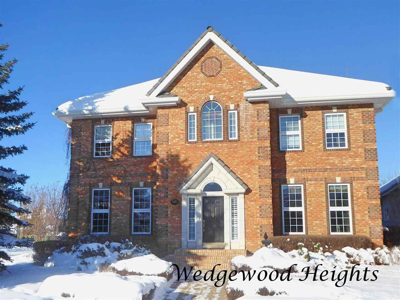 """Welcome to this charming Georgian """"Scott Arthur"""" built home located on a quiet street backing onto a treed ravine. Attention to detail and style is unsurpassed in this 4166 square foot brick beauty. Extensive use of high end finishings are found throughout this home including, striking crown moldings, hardwood and marble flooring, and beautiful built in cabinetry. Main floor features include entertaining sized living and dining rooms, a butler's pantry, a spacious chef's kitchen, huge family room and access to the 2nd level bonus room over the 4-car garage. The upper level has 4-bedrooms, the master with a luxurious 5-piece ensuite, 3 more bedrooms (one with its own 3-piece bath), the laundry room and a 4-piece main bath. The lower level has a family room, games room with wet bar, 5th bedroom, 4-piece bath and loads of storage. Wrought iron fencing encloses the English style grounds that include aggregate patios,  built-in Bar-b-que, gazebo and fire pit. A gracious residence, an impressive lifestyle."""