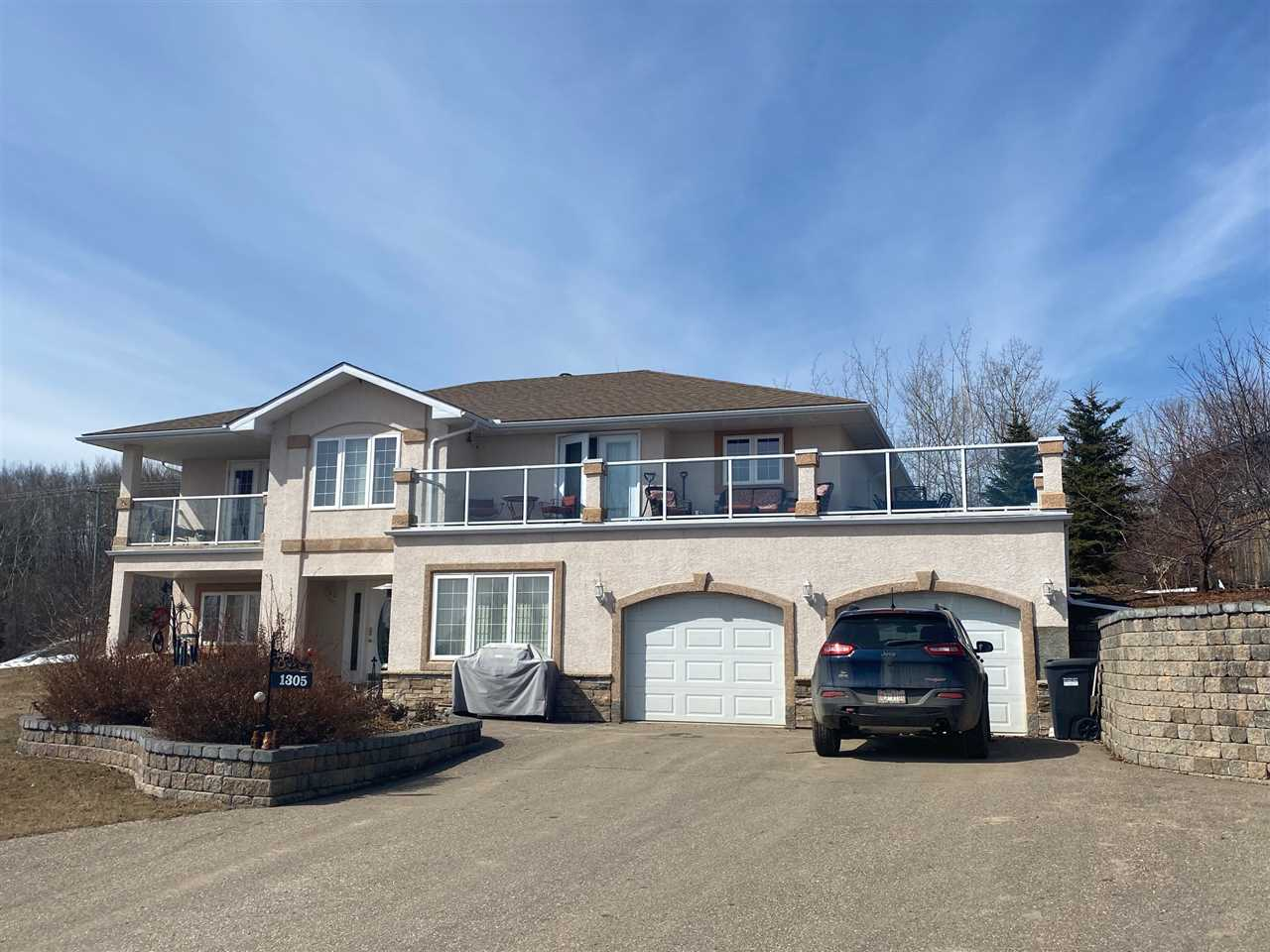 Lovely home at the end of a cul-de-sac! Sitting on a 1/2 acre landscaped lot on the slope while enjoying the views of Cold Lake! This custom built Glenwall home lends well to it's environment, the main floor living area is hardwood and tile that over looks the deck on the front of the house enjoying the lake. The efficient kitchen layout has plenty of cabinets, counter space, island and pantry, the dining area opens onto the deck, living room is open to both while down the hall you have access to the back yard, the laundry room, 2 bedrooms and a private master suite with it's own deck, his and her walk through closets to the ensuite with oversized shower, 2 person Jacuzzi tub, and double sinks. The lower entry level provides the welcoming foyer, rec room, family room, full bath, 2 additional bedrooms and access to the heated attached garage. The large retaining wall adds curb appeal and the paved driveway gives plenty of parking. The rear detached garage has room for the toys right next to the RV parking.