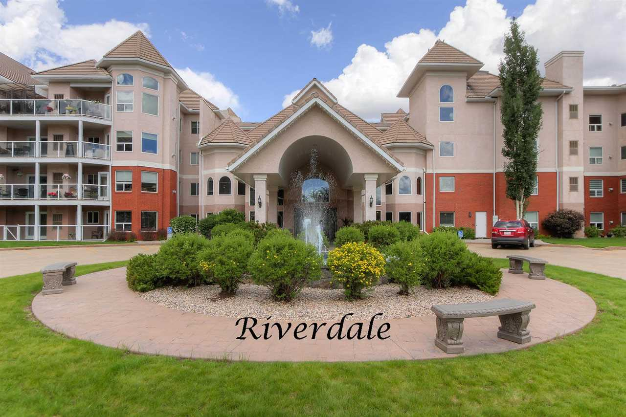 Terrific 2 BDRM/2 BATH condo in a pet friendly 18+ building located in the heart of Edmonton's beautiful river valley with walking and cycling trail at your doorstep. Features of this 1109 sq ft unit include an open floor plan, island kitchen with lots of cupboard space, corner pantry, 9' ceilings, gas fireplace, A/C, in-suite laundry, covered deck protected from the wind and rain, gas BBQ outlet, ample storage and a newer dishwasher, washer & dryer. Amenities in this well run building are an on-site manage, gym, guest suite, social room, games room with a billiards and shuffle board table, library and bike storage. There is an underground heated parking stall and storage unit. Just minutes from the U of A, downtown and the Ice District, this fantastic condo is a must to view!!