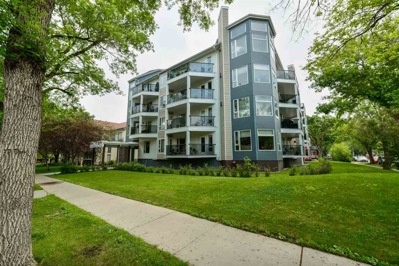 Absolutely beautiful Adult Condo located in Crofton House in desirable Oliver!  This spacious corner suite has large windows facing south and east onto a beautiful quiet, tree-lined street.  The open-design kitchen is perfect for entertaining.  The bright living room features large windows and a gas fireplace.  A garden door off the dining room leads to the balcony, providing easy access to your BBQ year-round with a convenient gas connection!  The Master Bedroom is spacious with a walk-in closet and ensuite with tub.  The second bedroom/den would also be excellent as a home office.  In-suite laundry with storage area, half bath, and parking stall complete this unit in a very well-managed building.  The exterior has been completely redone with new siding, windows, garden doors, balconies, exterior front entry, and shingles.  All utilities except power are included in the condo fee.  Perfectly located to access the downtown, General Hospital; walkable to all amenities; steps to the Grandin LRT station.