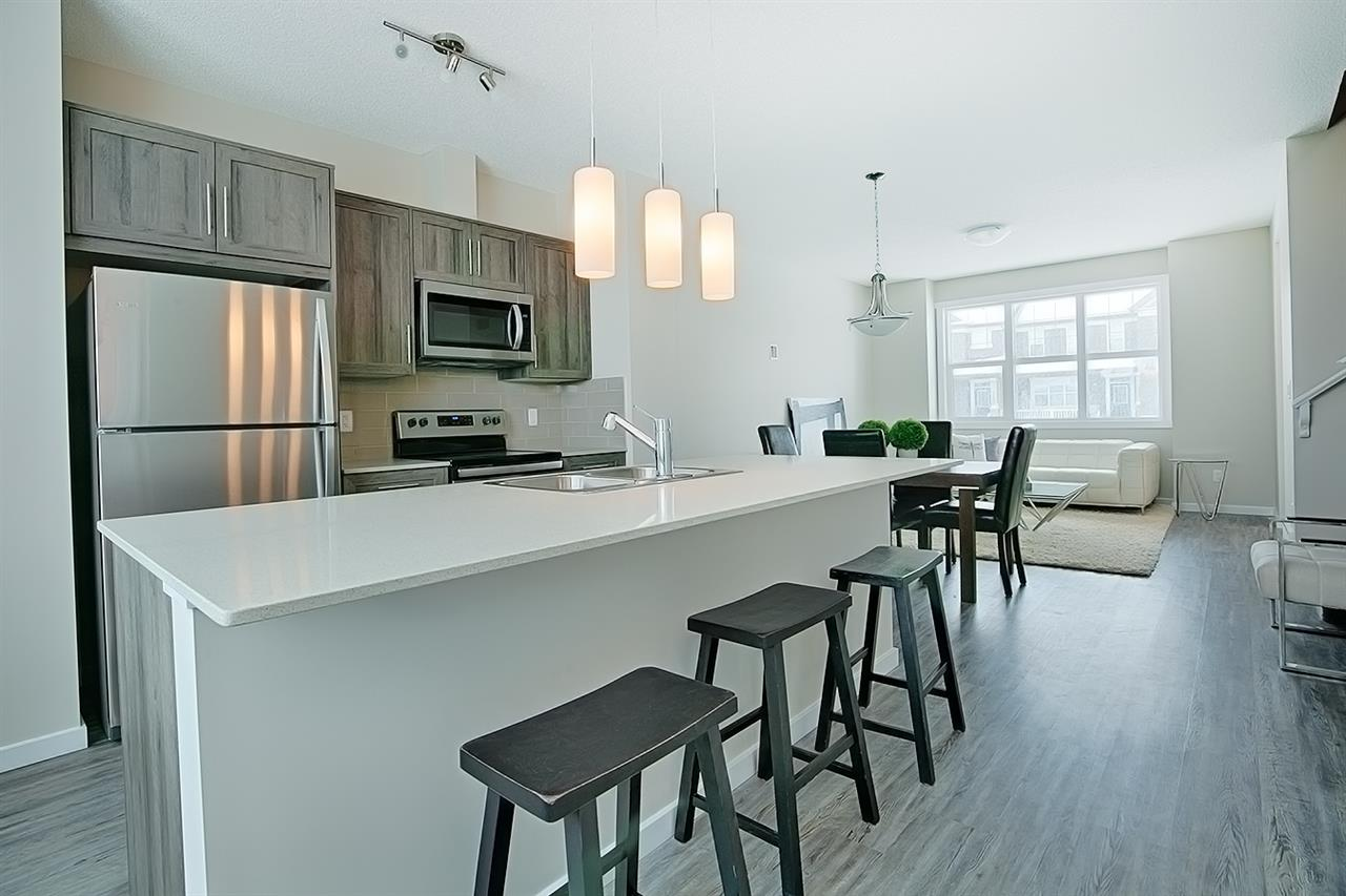 """This beautiful Homes By Avi zero condo fee, corner unit street town is located in the prestigious community of Glenridding at Windermere. Located just a few doors down from the playground a future school, this home is an absolute must see! Featuring an open concept main floor with 9' ceilings, luxury vinyl plank flooring throughout, quartz countertops in the kitchen, stainless steel Whirlpool appliances, soft closing cabinetry, added pot and pan drawers for your convenience, and a large 8'4"""" kitchen island! Upstairs you'll find 3 spacious bedrooms, 2 bathrooms with upgraded quartz countertops, an upgrade 5' glass shower in the ensuite, and built in cabinetry for extra linen storage. Your washer and dryer is in the undeveloped basement with a window and roughed in plumbing for future development. A 20' x 22' detached garage, rear deck with BBQ gas line, and full landscaping completes this turn key ready home."""