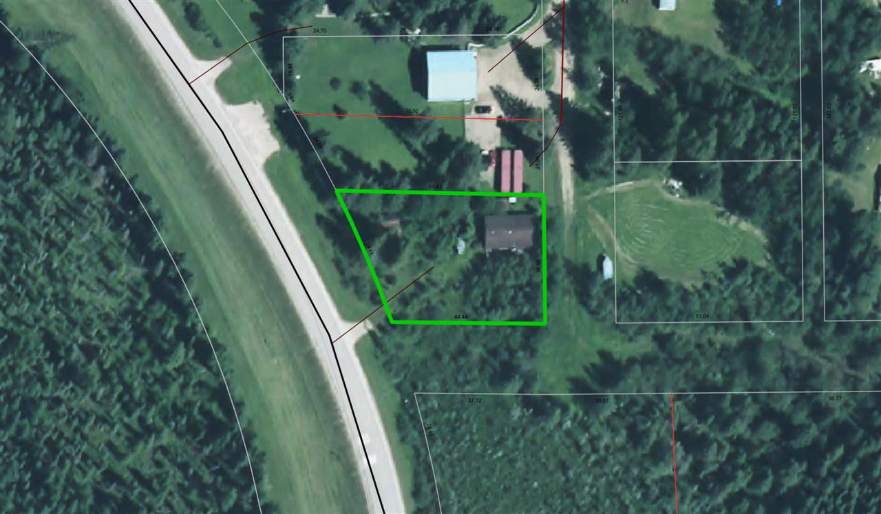 With plenty of trees and space to build, this affordable, almost half-acre lot in the village of Winfield is the perfect spot for a private residence. The former apiary is on pavement with back lane access. Don't miss your opportunity to own this great property. Some buildings are still on the property and the owners do not warranty their Condition.
