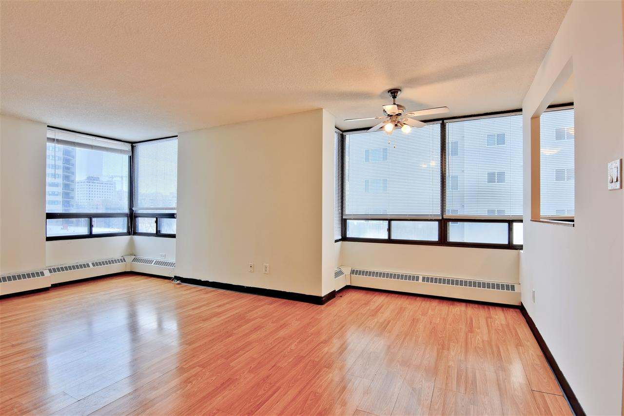 YOUR DOWNTOWN LIFESTYLE AWAITS!  This 1 bedroom + 1 bath, 4th floor southeast corner unit in The Hargate, is perfect for students, professionals or investors.  Main features are: bright living room with a view of Jasper Avenue, updated kitchen and bathroom, spacious bedroom with walk in closet, easy care flooring throughout, and same floor common laundry.  You will enjoy your heated underground parking stall, 2 elevators, visitor parking and all utilities which are included in condo fees.  This fantastic location will be your epicenter to the River Valley, Brewery District, Roger's Place and the Downtown core with all the shops, galleries, and fine dining.  Quick access to U of A, Grant MacEwan and NAIT via ETS and LRT.  SMART MOVE!