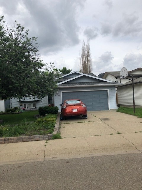 3 Bedroom 1175 sq ft Bi-level with a 2 car Attached garage in a great crescent in Pollard Meadows .  Large lot , back alley and much more