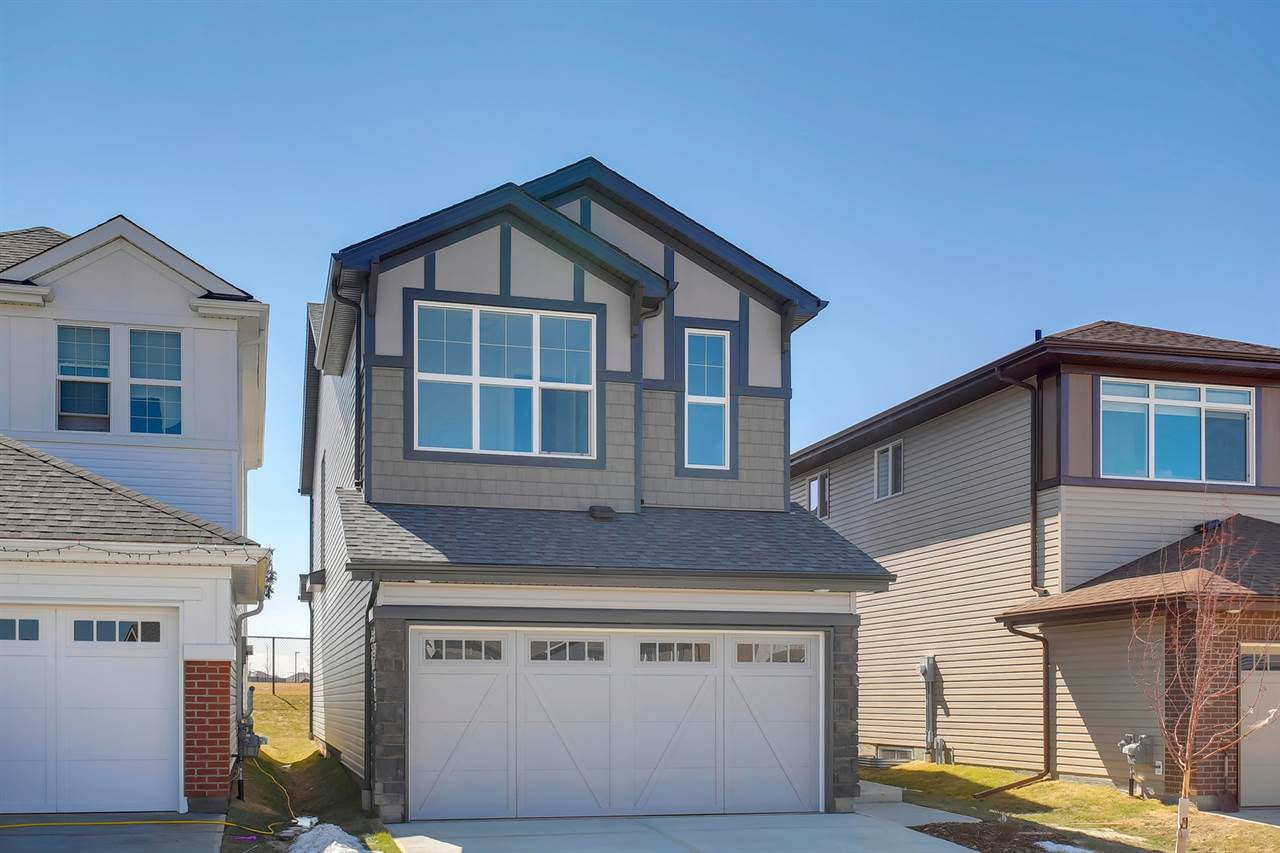 Chappelle - Daytona Homes does it again with The Aviator-z 2073sqft ? incredible location backing onto a park! Everything a family is looking for ? architecturally upgraded inside & out ? landscaped - 3 beds, 2.5 baths, living room - fireplace (electric), bonus room, 9ft ceilings in basement & upgrades throughout!  Step inside & you will love the bright & open concept main floor. The wall of windows in the living room allows for the natural light to flow throughout. Continue on into the kitchen with upgraded cabinets, peninsula island/breakfast bar, quartz counter tops & walk-in pantry. Open to the kitchen is the dining area with metal railing separating it from the step-down spacious living room with access to the backyard. Main floor bath & storage completes this level. Upstairs ? the bonus room is perfect for the family! The master suite includes a dressing room & spa like ensuite - 2 sinks, soaker tub & glass shower. Beds #2 & #3 are both a good size, bathroom - 2 sinks & laundry complete this home!