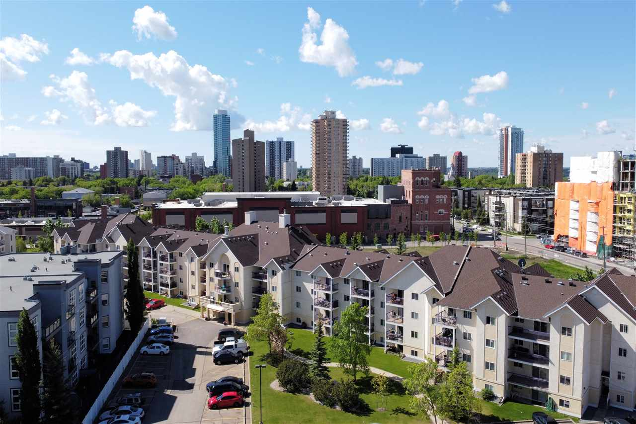 YOUR URBAN LIFESTYLE AWAITS!  This 2 bed plus 2 bath condo, on the 2nd floor in The Pointe Uptown, is perfect for students or professionals.  Main features are: spacious living room with sliding doors, bright kitchen with dining area, IN-SUITE LAUNDRY, A/C, and covered balcony with a view of landscaped courtyard.  Master bedroom offers 4pc en-suite and walk through closet, while the 2nd bedroom is beside the main 4pc bath.  Upgrades include: easy care flooring throughout, newer baseboards and fresh paint.  You will enjoy your covered parking stall and all utilities which are included in condo fees except power.  This great location will be your epicenter to the Brewery District, 124th street amenities and the Downtown core with all the shops, galleries, fine dining, and Roger's Place.  Convenient  to U of A, Grant MacEwan University and NAIT via ETS and LRT.  MOVE IN READY!