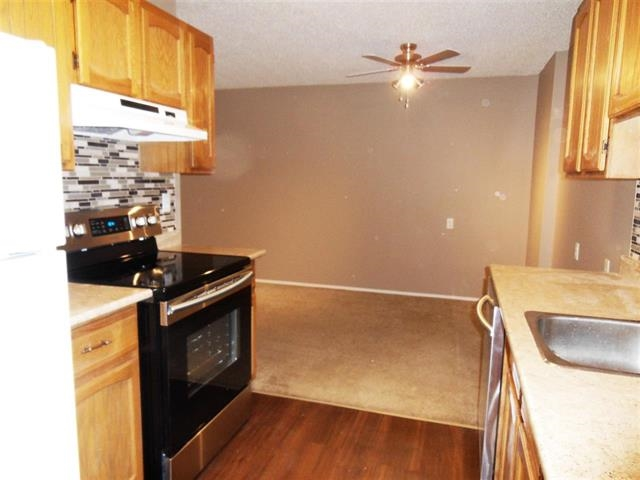 Excellent value in this 2 bedroom condo perfect for first time buyers or investors! Don't miss out on such a great chance to become a homeowner today! The kitchen has been nicely updated with new backsplash, countertops, and new appliances! There is an updated 4 piece bath, and an extra large storage room. You have a wonderful spacious, walk out patio to sit and enjoy the summer weather. This unbeatable location in Kiniski Gardens is close to Whitemud, easy access to Anthony Henday, public transit, as well as having many amenities close by.  You won't be disappointed!