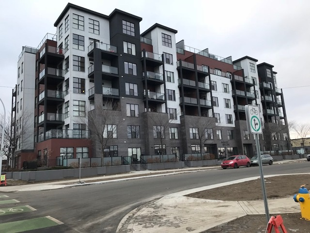 """Exceptional Executive Furnished Suite in The Maxx, facing east with a view of the downtown Edmonton & the Ice District from the living room and master bedroom. Walk across the street into Oliver Square Shopping Center or take the new bike path to the Brewery District. A concrete and steel building, well designed contemporary suite with a large living room and garden door to the balcony, large master bedroom, second bedroom/den with a window to the courtyard, 3-piece ensuite with oversize shower and a 4-piece main bath, laundry and storage. """"See the pictures"""" big kitchen with granite counters and stainless-steel appliances, island and breakfast bar and a dining area that will seat 6-8 guests. Privately controlled heating and AC unit in the suite and roughed-in gas outlet on the balcony. One titled parking stall and lots of visitor parking on the street and on site. The district is being revitalized with new roads, sidewalks 2020. Proposed park area in front of the Maxx."""