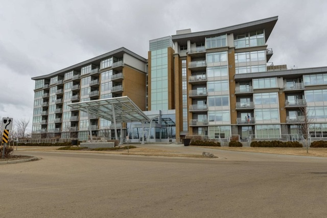 PENTHOUSE condo.  Top floor lowrise apartment condominium located in southwest Edmonton.  Concrete building in One Century Park complex.  Built with impeccable materials and standards.  West and northwest views out of this unit looking over open space.  2 bedrooms and 2 bathrooms floor plan.  High ceilings throughout unit including 20 foot cathedral ceiling in living area.  Large master ensuite with his and hers vanity, soaker tub and glass surround shower.  Upgrades include marble and granite specs, fireplace, air conditioning, top end stainless steel appliances, gas countertop stove, built-in oven, large island breakfast bar, insuite laundry and full blinds window treatment.  Included with condo unit is a titled underground parking stall and a titled storage unit.  Condo is conveniently situated for a its walk ability to YMCA fitness center, shops, banks and restaurants.  A quick walk to the LRT station taking you just minutes to University and downtown. Easy access to Anthony Henday Road & Whitemud Dr.