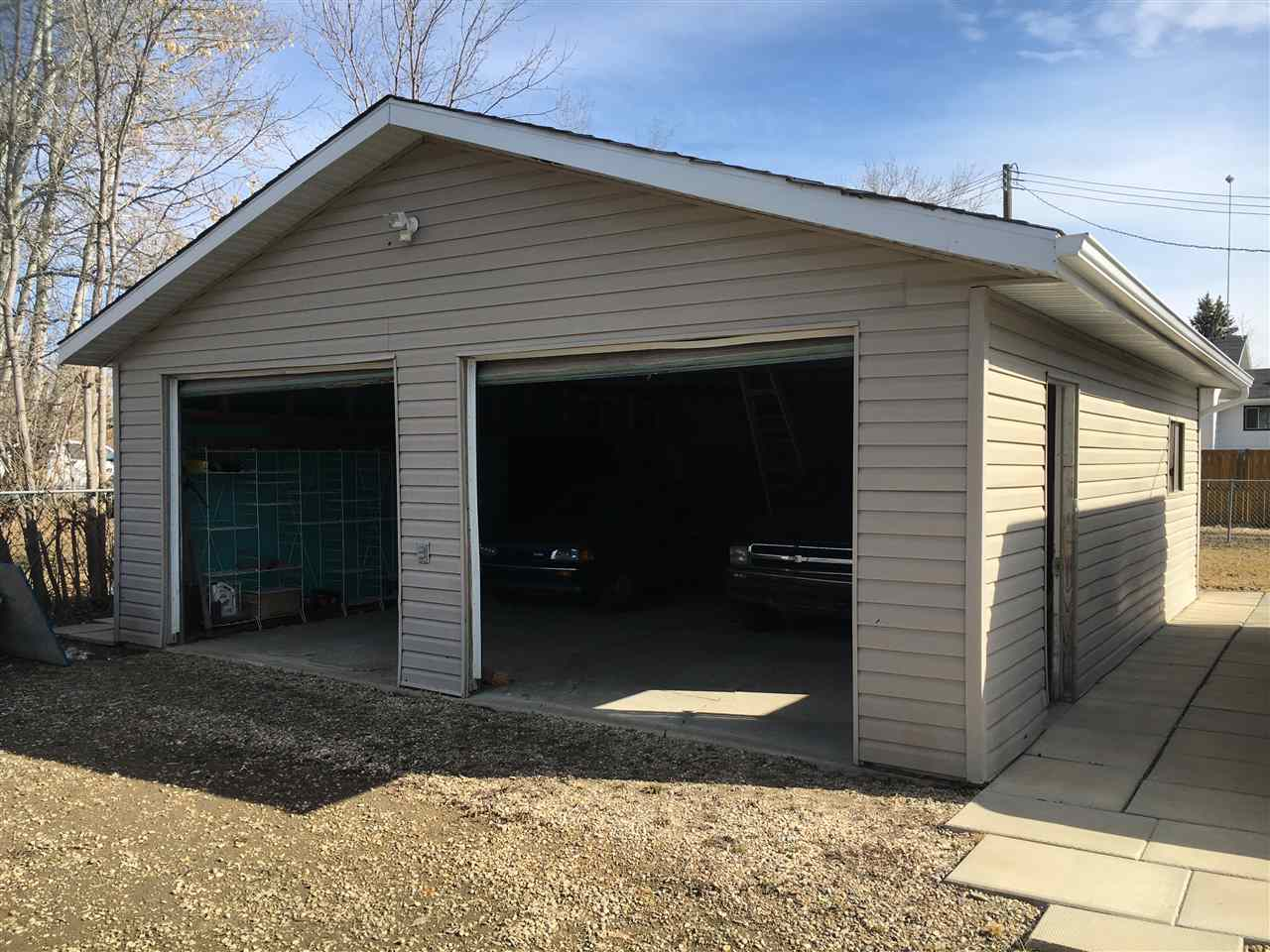 Oversized double garage built in 1986 on 45x115 foot lot. Partially fenced.
