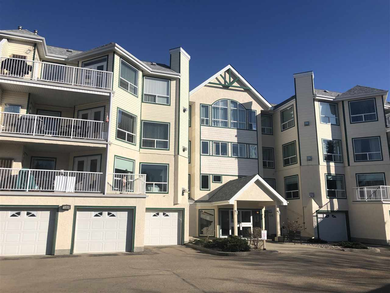 Prime Central St. Albert Location! Steps to the Sturgeon River Valley trails, public transportation and walk-able shopping to groceries, the mall & the Shops of Boudreau! This top floor unit is bright and homey feeling and features 2 Bedrooms & 2 Full Bathrooms & 2 Parking Spaces! The spacious entrance is adjacent to the in-suite laundry & storage room, and updated white kitchen. The galley style kitchen features new corian countertops, additional pantry storage, and cabinet hardware. The central dining space and living room feature large windows w/ new window coverings, gas fireplace and access to your private deck. The spacious master bedroom features dual walk-through closets, and a roomy 3 piece ensuite. The 2nd bedroom also has its own 4 piece ensuite! This unit also features an oversized single detached garage and a powered outdoor stall. Professionally managed condo w/ a guest suite & fitness room! All the comforts of a single family home but with no maintenance!