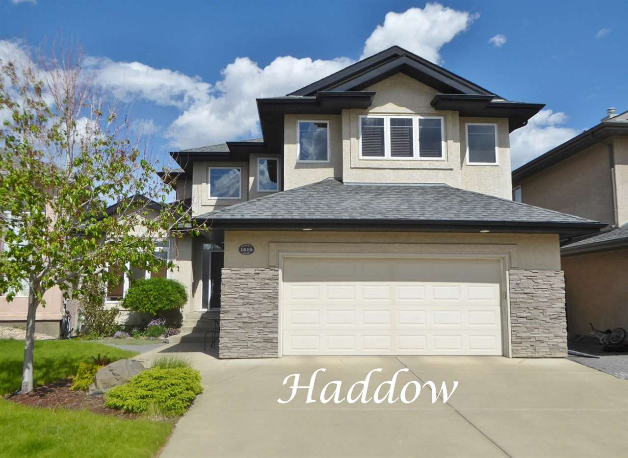 """Imagine coming home to this terrific """"Birkholz"""" built 2546 sq ft 2 storey with a fully developed WALKOUT basement backing a green space! It features a bright & airy floor plan w/9 ft main floor ceilings, solid maple flooring, huge floor to ceiling windows & a spacious deck overlooking the walking trails & greenbelt. The main floor has a spacious front foyer, open concept living & dining rooms, den/music room, 2-pce powder room, & the laundry. The upper level has a large master BDRM w/a modern 4-pce ensuite including an over-sized shower & double sinks. There are two additional """"Jack & Jill"""" style BDRMS, one with a W-I closet. Completing the upper level is a spacious bonus room w/built in cabinetry & glass block accents. The lower level has a large RR, also with floor to ceiling windows & a wall of pretty built in cabinetry including the gas FP & mantel. This level has two additional BDRMS, a 3-pce bath & access to the patio overlooking the lovely yard. Located in a quiet cul-de-sac, it's a must to view!"""