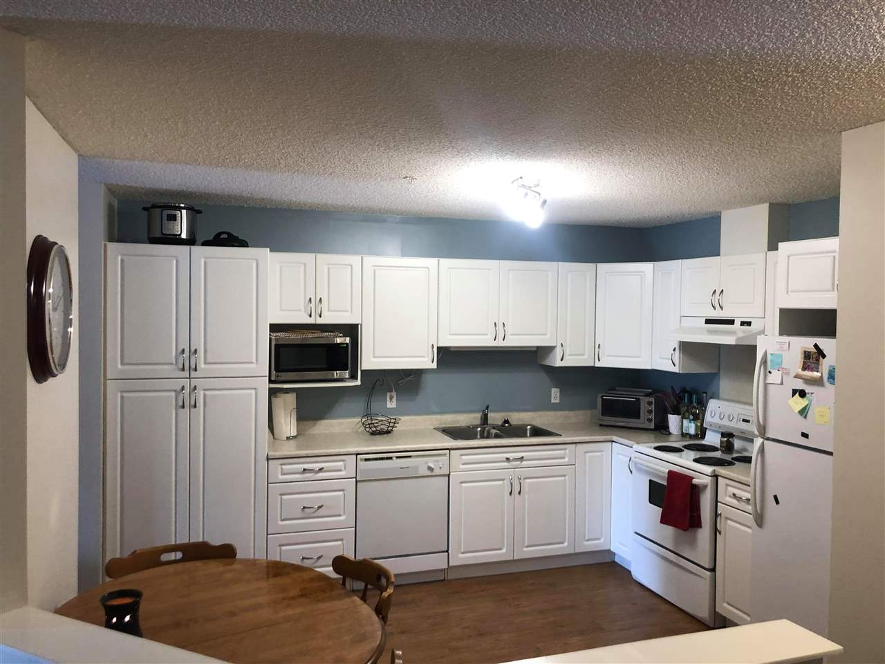 Amazing location for Professionals working downtown or Students going to NAIT, GR. MacEwan or the U of A!  Central Location backing onto Queen Mary Park. This freshly painted condo has a unique layout.  2 Bdrms, 2 Bathrooms.  A large kitchen with newer fresh, white cabinetry, with tons of storage & a large pantry, and open to the Breakfast Nook.  A large living room overlooking the nicely sized south facing balcony with additional locked storage.  Never pay for laundry again with IN-suite laundry and a brand new Washer.  All this with one Titled Parking Stall.