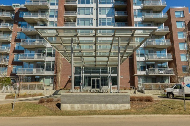 PENTHOUSE condo with 950 sqft balcony deck. Top floor lowrise apartment condominium in southwest Edmonton.  Concrete building in Regent Century Park complex.  Built with highest materials and standards.  Sunny west and southwest views out of this unit looking over open space.  2 bedrooms floor plan.  High ceilings throughout unit including 16 foot cathedral ceiling in living area.  Large master ensuite with tiled surround shower stall.  Upgrades include marble and granite specs, air conditioning, top end stainless steel appliances, gas countertop stove, built-in oven, large island breakfast bar, insuite laundry and full blinds window treatment.   Included with this condo unit are titled underground parking stalls and a titled storage locker.  Condo is conveniently situated for its walk ability to YMCA fitness centre, shops, banks and restaurants.  A quick walk to the LRT station taking you just minutes to University and downtown.  Easy access to Anthony Henday Road and Whitemud Drive,