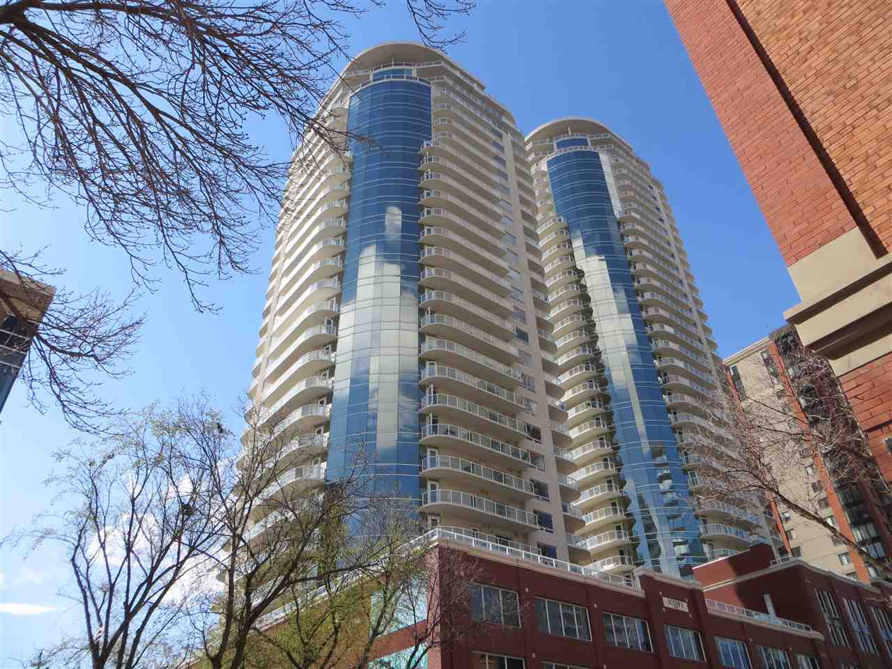 Hard to find condos this size in this price range!  Over 1200 sq ft 24th floor unit with 2 balconies with sweeping north, east and south views that overlook Rogers Place, the river and Re/Max Field. Sweeping east facing downtown skyline views from your living room and kitchen.  This upgraded unit includes: 9 foot ceilings, hardwood and tile flooring, A/C, stainless steel appliances, granite counters in the kitchen and bathrooms, tandem underground parking stall, master bedroom with walk in closet and built in shelving, and a private balcony off master perfect for morning coffee.  2nd bedroom is a good size as well.